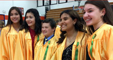 Photo of a group of students smiling for a photo at eighth grade promotion