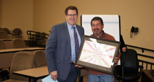 Photo of Superintendent Stelter presenting Board Member Jorge Sanchez with a thank you gift