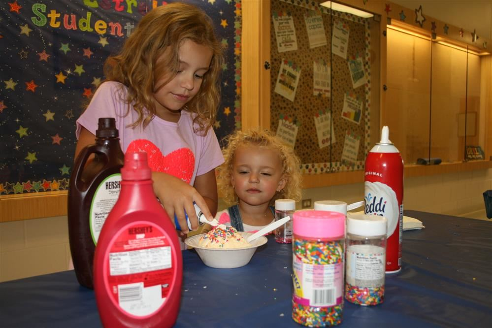 Photo of two Johnson students making sundaes at the PTA's ice cream social