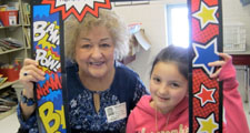 Photo of a Project CARE mentor and a student smiling for a photo with a colorful comic book frame