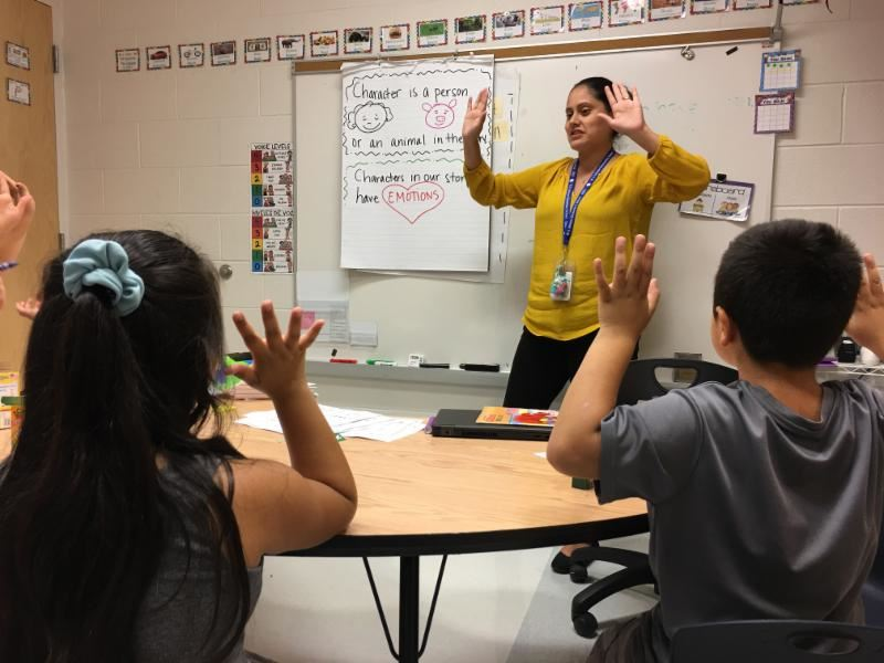 Yuri Zepeda, a bilingual resource teacher at W.A. Johnson School, working with a small group of students.